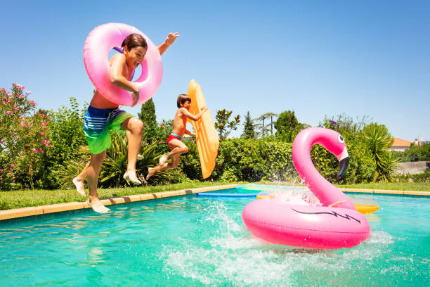 Happy friends enjoying pool party in summer stock photo