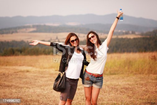 istock Happy friends enjoying the nature 174998252