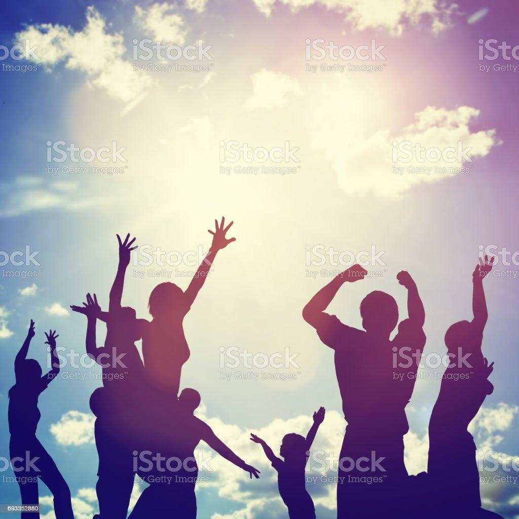 Happy friends, family jumping together in a circle having fun and...