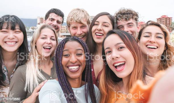 Happy friends from diverse cultures and races taking photo making picture id1147070880?b=1&k=6&m=1147070880&s=612x612&h=ozj l20qk0j5inzvbjdoyqa8ltq4lky m2mhnpin14s=