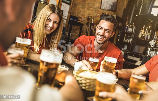 istock Happy friends group drinking beer at brewery bar restaurant - Friendship concept with young people enjoying time together and having genuine fun at cool vintage pub - Focus on guy - High iso image 952414774