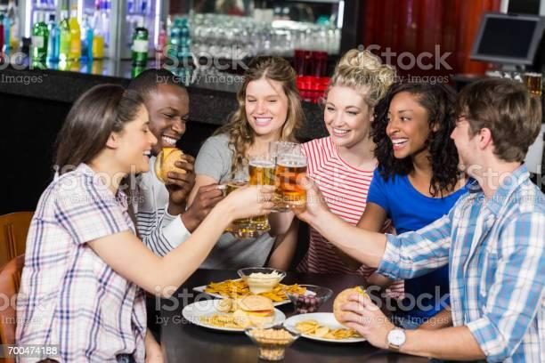 Happy friends having a drink and hamburger picture id700474188?b=1&k=6&m=700474188&s=612x612&h=f6 ncjspi tvdvaz8fzxrob7 f8j5n1pfhjmsvx dua=