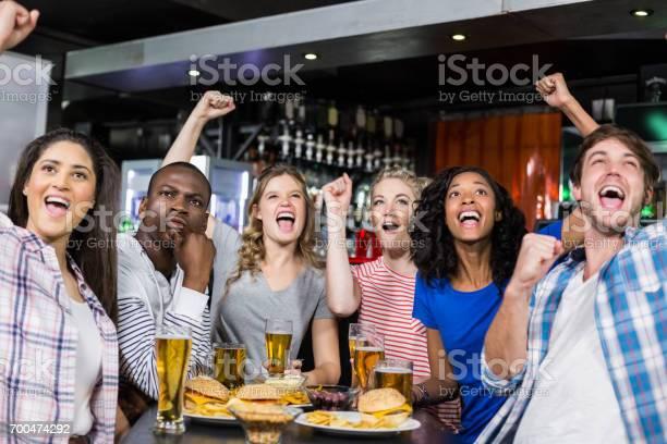 Happy friends having a drink and watching sport picture id700474292?b=1&k=6&m=700474292&s=612x612&h=3hcbjyyzkc5eiddm7dkl2q7fg0e5hepcln0yzy030w8=