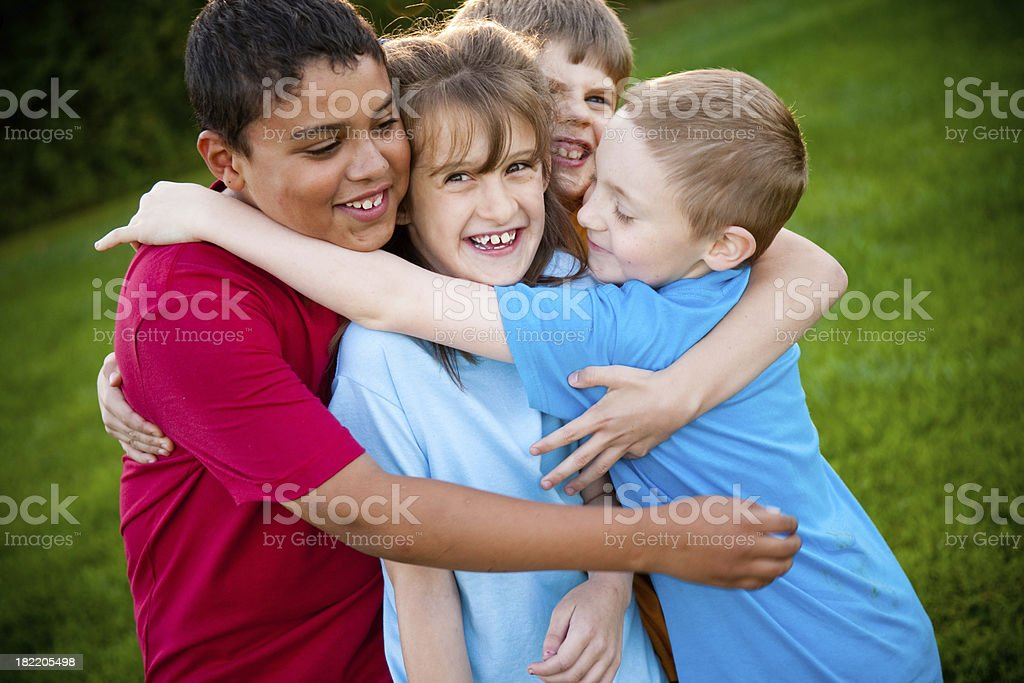 Happy Friends Having a Group Hug royalty-free stock photo