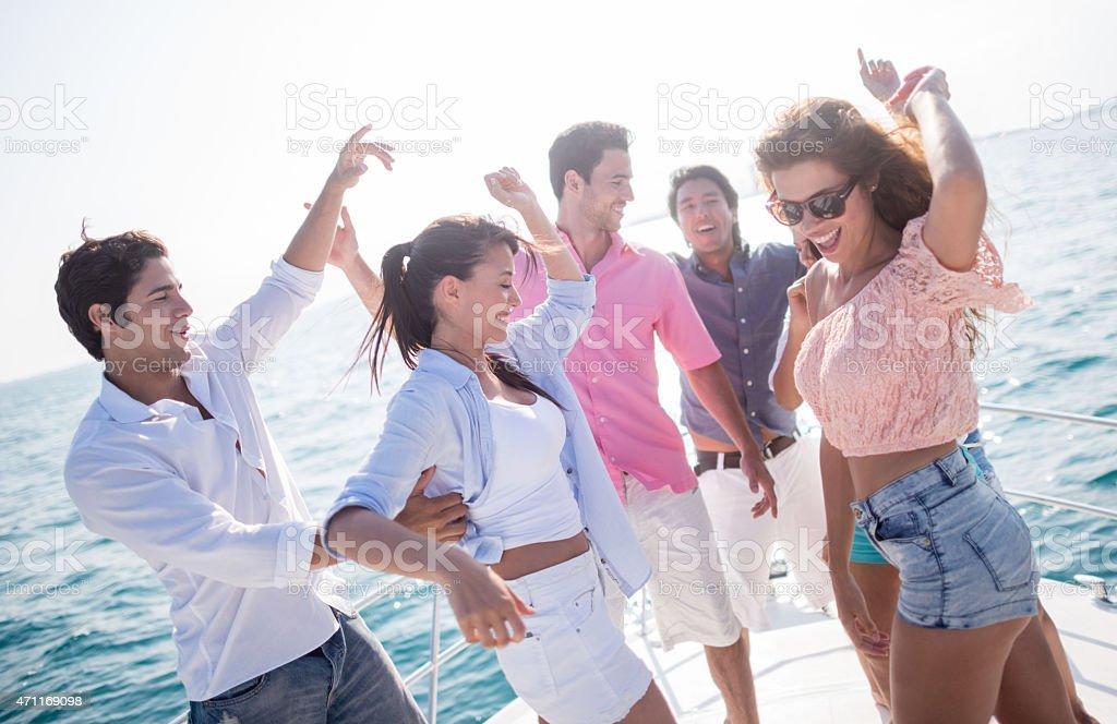 Happy friends having boat party stock photo