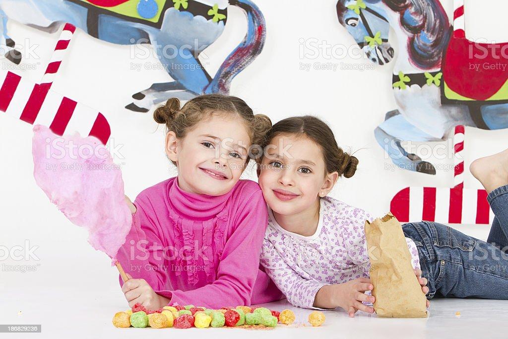 Happy friends having fun at amusement park - studio shot royalty-free stock photo