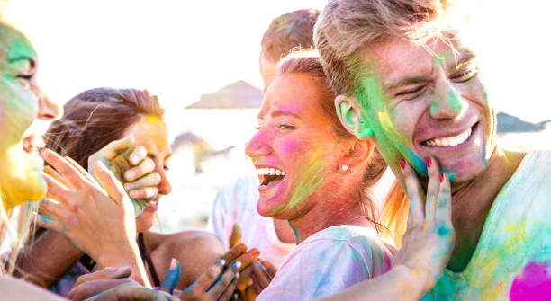 happy friends having fun at beach party on holi colors festival event - young people laughing together with candid excited mood at summer vacation - youth friendship concept on vivid contrasted filter - concert selfie stock photos and pictures