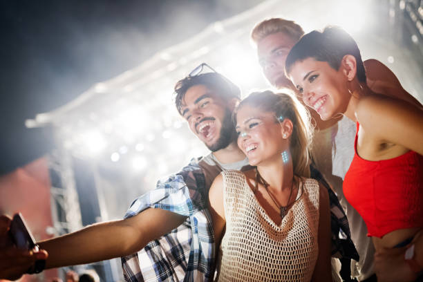 happy friends having fun at music festival - concert selfie stock photos and pictures