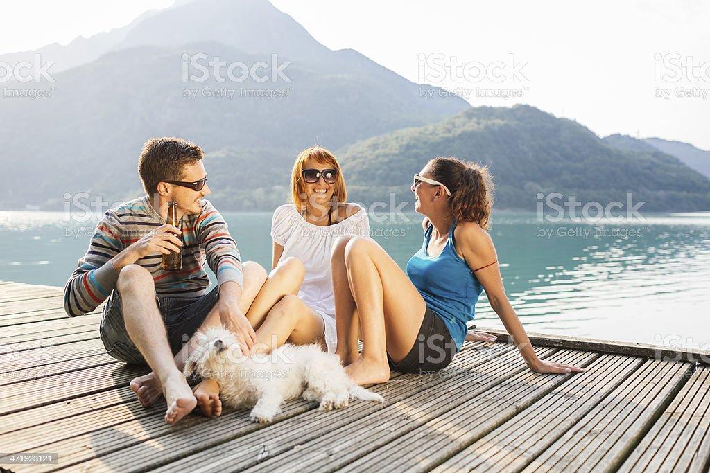 Happy friends having fun at the lake royalty-free stock photo