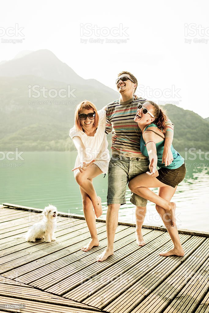 Happy friends having fun during a day on lake royalty-free stock photo