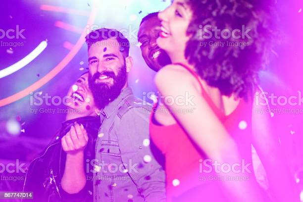 Happy friends having fun in night club with canon ball throwing picture id867747014?b=1&k=6&m=867747014&s=612x612&h=5 s tcee jwhsfahddep syq yh4ozfb5fjjpeawm6y=