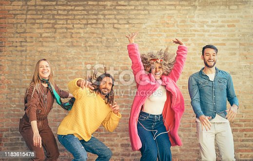 861023492 istock photo Happy friends having fun together outdoor - Crazy young people dancing and celebrating in the city - Concept of friendship with celebration and youth lifestyle 1183615478