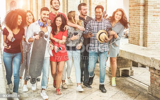 istock Happy friends having fun walking in city center - Young students laughing and enjoying time together outdoor - Youth, trendy lifestyle and friendship concept - Main focus on right people 900850114