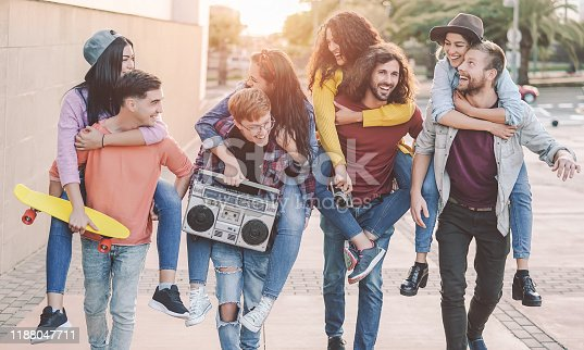 861023492 istock photo Happy friends having fun walking piggyback in the city center - Group young people laughing and sharing time together outdoor - Youth culture   friendship people lifestyle concept 1188047711