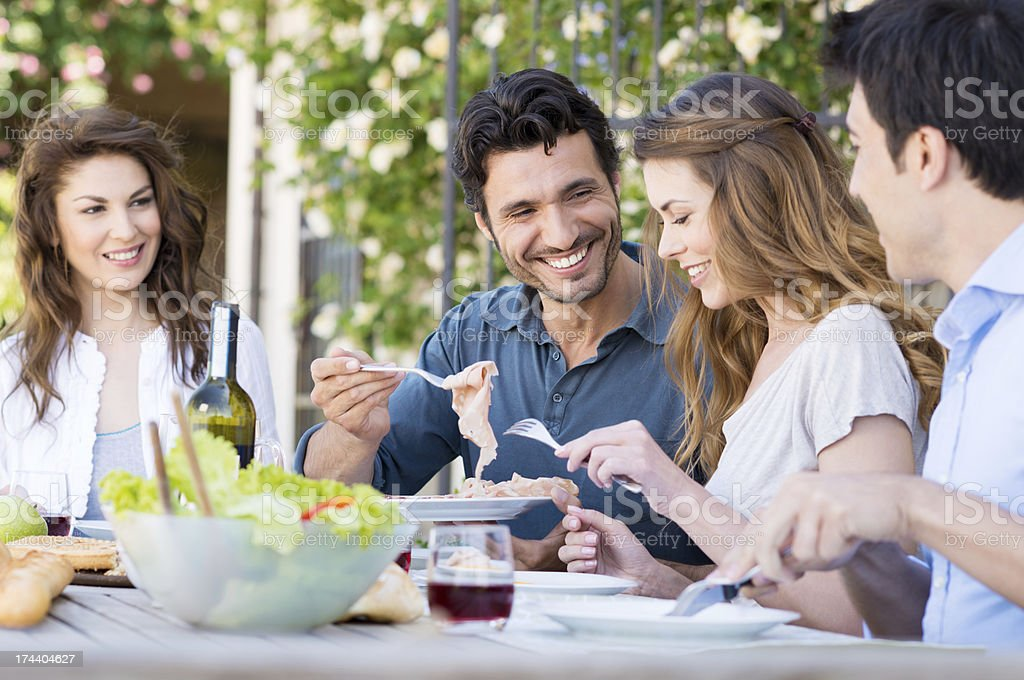 Happy Friends Having Lunch stock photo