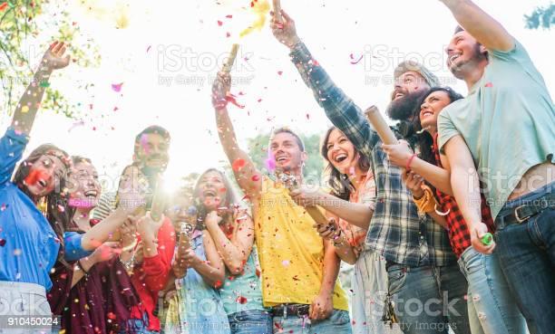 Happy friends having partythrowing confetti and using smoke bombs picture id910450024?b=1&k=6&m=910450024&s=612x612&h=fa7rkd6xb3fv8uc7jf0ddxtuktl31thcyyixx5wz7fg=