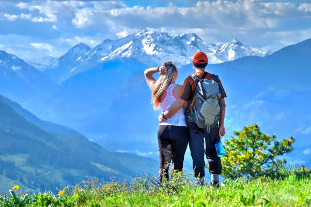 Happy friends hipsters  hiking in mountains. stock photo