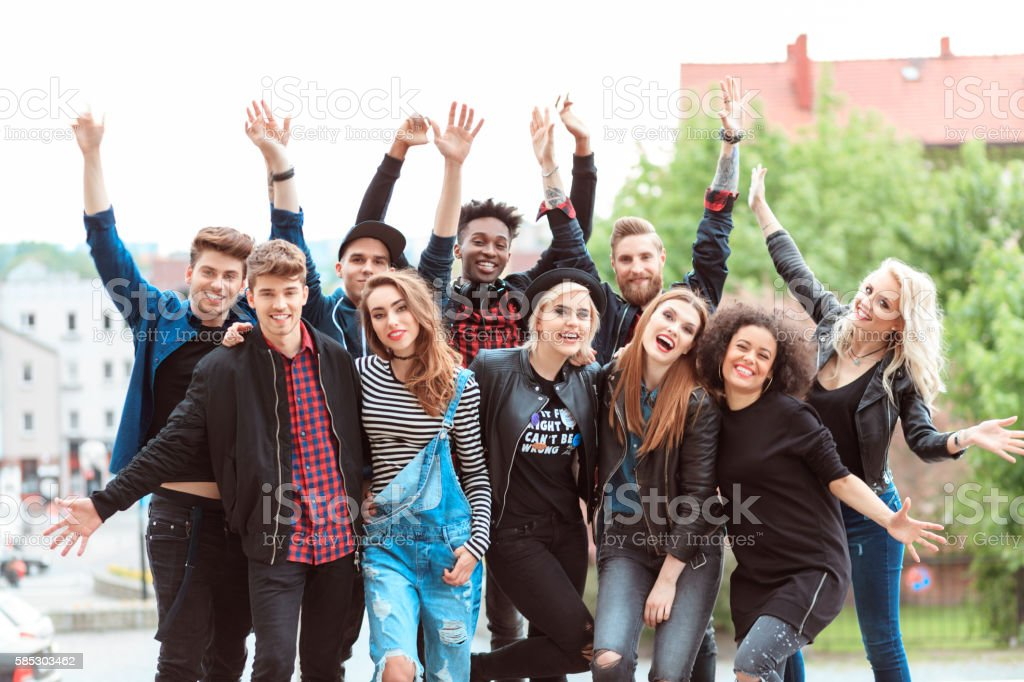 Happy friends in the city Multi ethnic group of young people smiling at camera, outdoor in the city. 20-29 Years Stock Photo