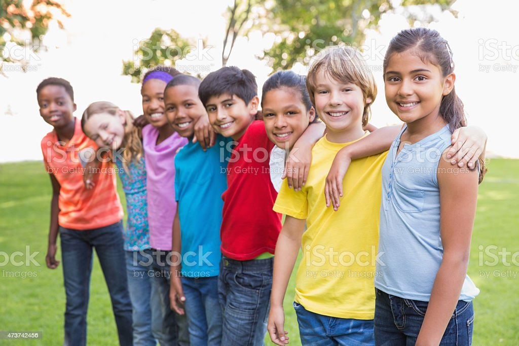 Happy friends in the park stock photo