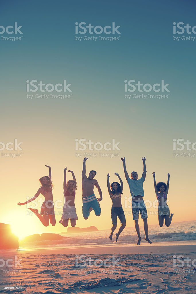 Happy friends jumping in row stock photo