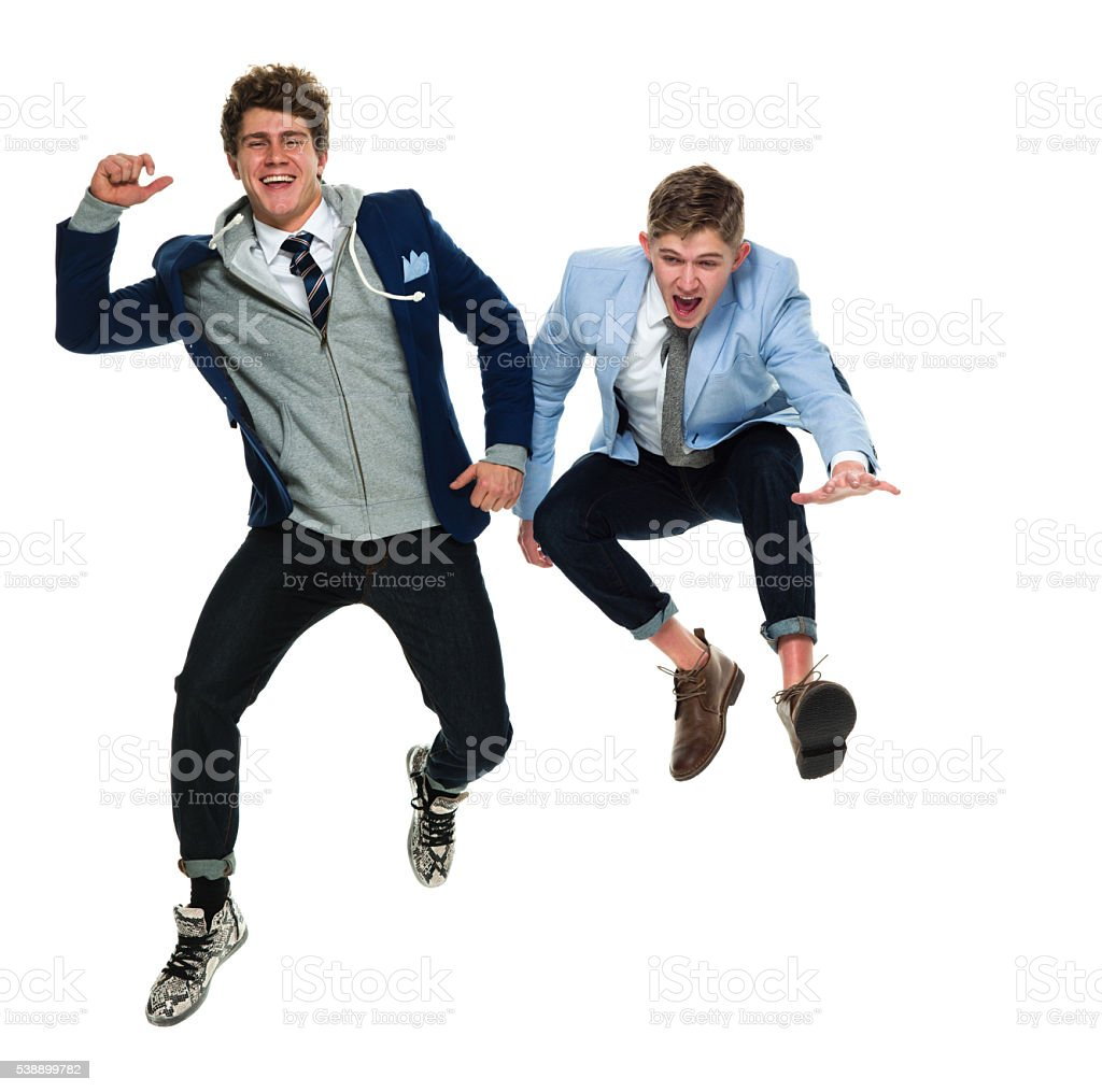 Happy friends jumping together stock photo