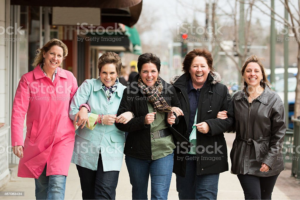 Happy friends laughing together stock photo