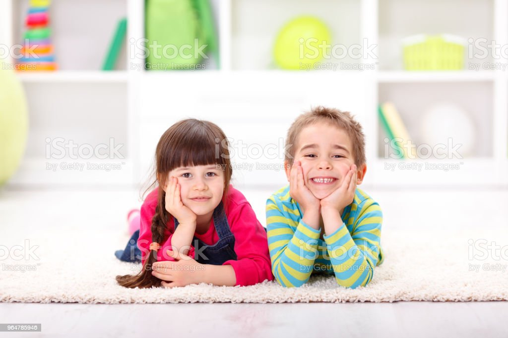 Happy friends lying on the floor royalty-free stock photo