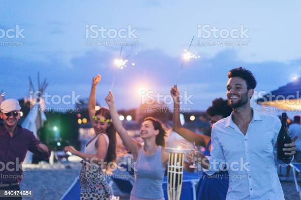 Happy friends making evening beach party outdoor with fireworks and picture id840474654?b=1&k=6&m=840474654&s=612x612&h=ayzda80sjxjeegjek5zqiqu1lolyodgxas9t2bbg5pm=