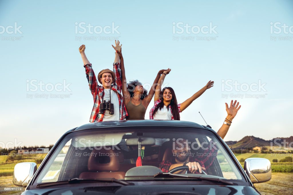 Happy friends on board of a pick-up truck stock photo