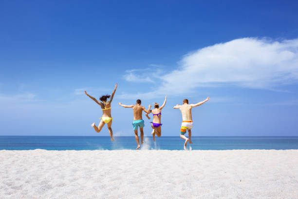 Happy friends on lonely beach - foto stock