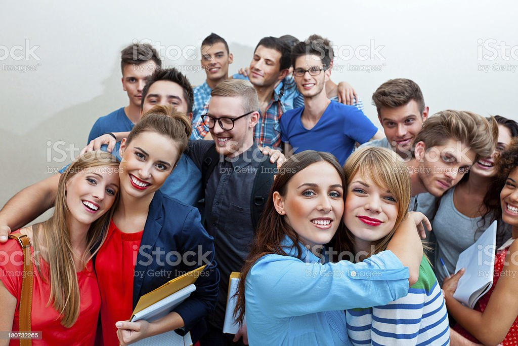 Happy friends Large group of young adult people embracing and laughing at the camera. 20-24 Years Stock Photo