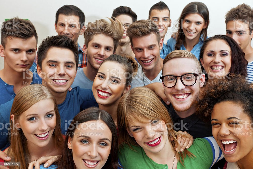 Happy friends Large group of young adult people laughing at the camera. Close up of faces. 20-24 Years Stock Photo