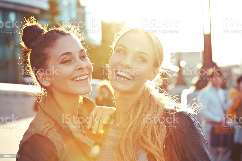 Happy Friends Outdoor portrait of two happy young women. 20-24 Years Stock Photo