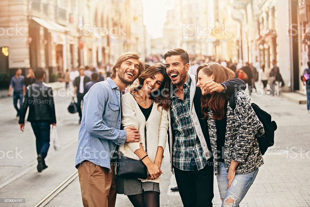 Happy friends Four happy friends smiling and having fun. 20-29 Years Stock Photo