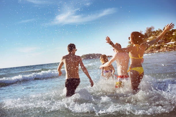 happy friends sea beach holidays - beach stock pictures, royalty-free photos & images
