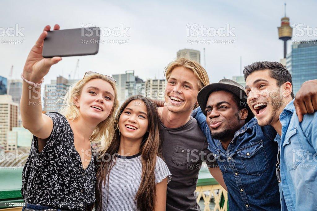 Happy Friends shooting Selfies Darling Harbour Sydney stock photo