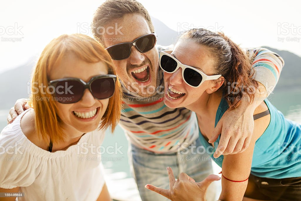 Happy friends smiling together royalty-free stock photo