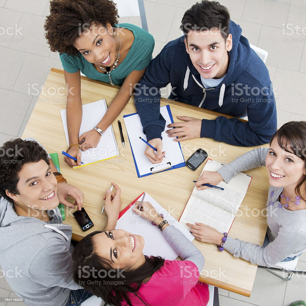 Happy Friends Studying Together stock photo