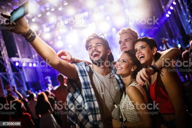 Happy friends taking selfie at music festival picture id873590486?b=1&k=6&m=873590486&s=612x612&h=heki5mp rpexnwm vfkavof5txxeq1 tntwxvibblnw=