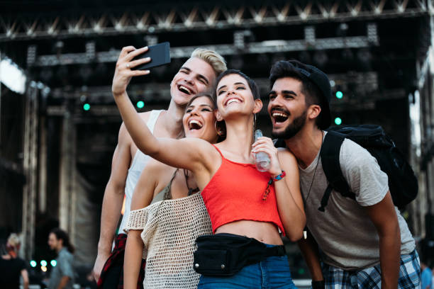 happy friends taking selfie at music festival - concert selfie stock photos and pictures