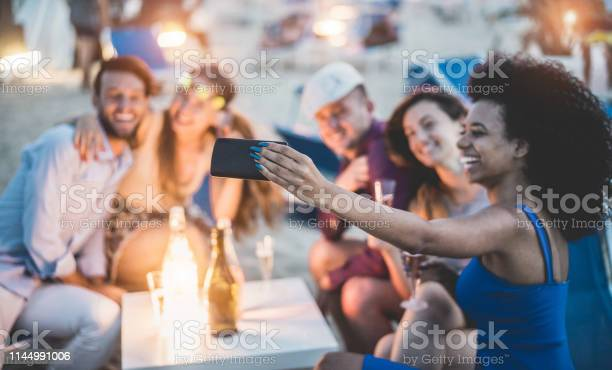 Happy friends taking selfie with smartphone at beach party outdoor picture id1144991006?b=1&k=6&m=1144991006&s=612x612&h=c5z68w2wvzr8acuyxrbhucbcde9 e76g8rblewt kqe=
