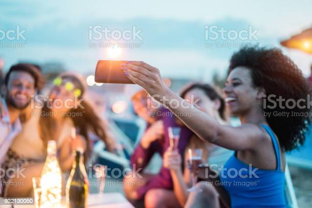 Happy friends taking selfie with smartphone at beach party outdoor picture id922130050?b=1&k=6&m=922130050&s=612x612&h=vvnvjlqu1twye43w z78yiynwgyk rj0iu1zjlbf98a=