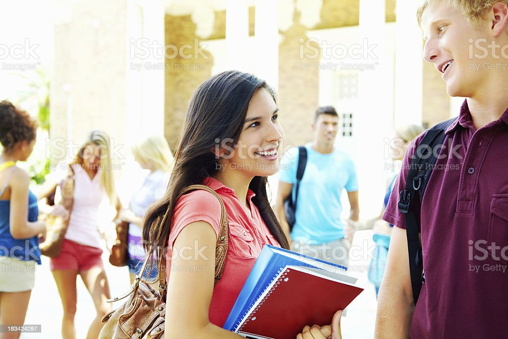 Happy friends talking on campus royalty-free stock photo