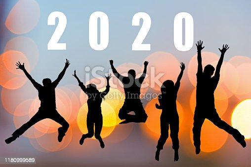 istock Happy friends team work and adult people jumping congratulation graduation in Happy New year 2020. 1180999589
