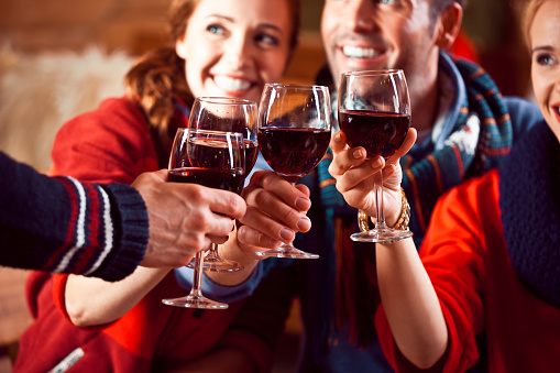 Happy Friends Toasting With Wine In The Evening Stock Photo - Download Image Now