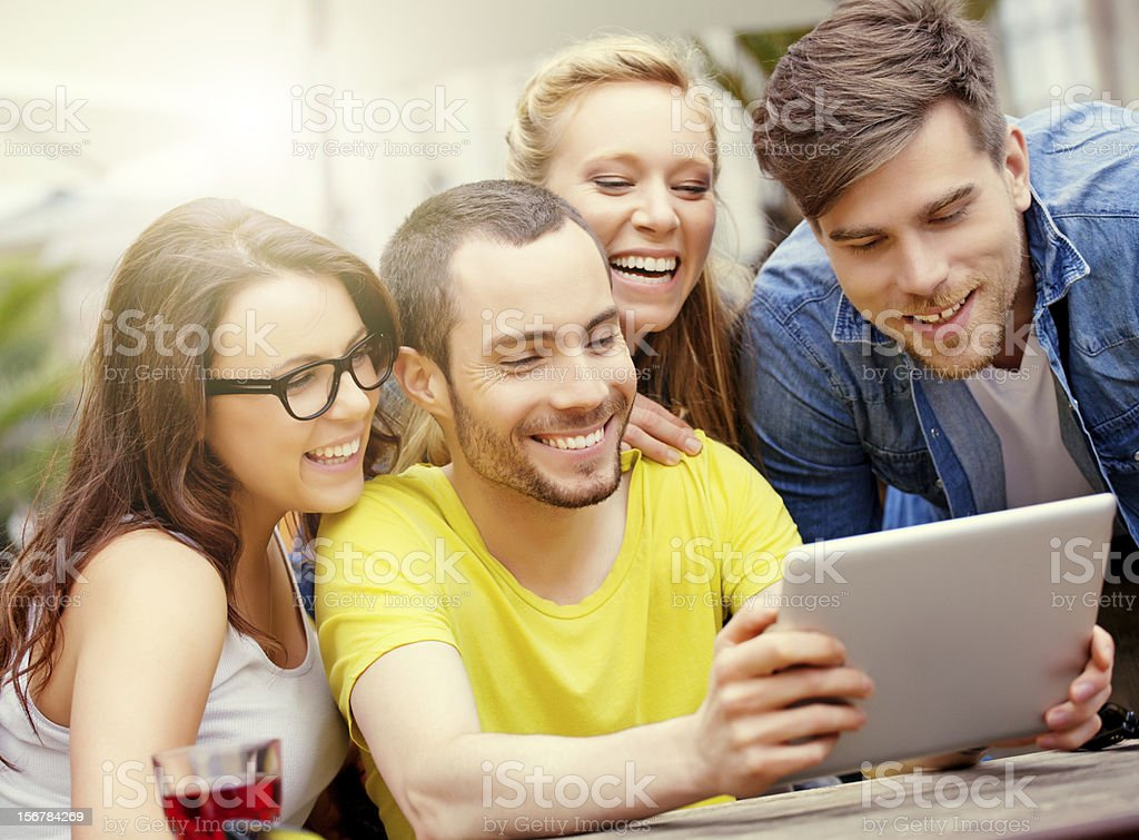 happy friends using digital tablet outdoors royalty-free stock photo