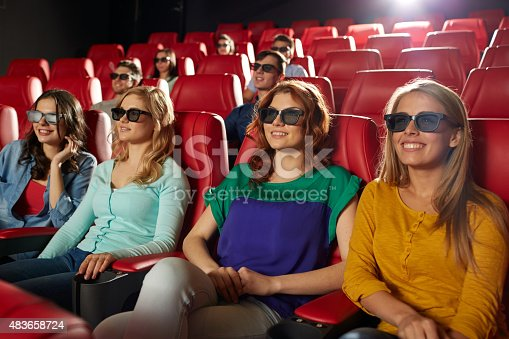 istock happy friends watching movie in 3d theater 483658724