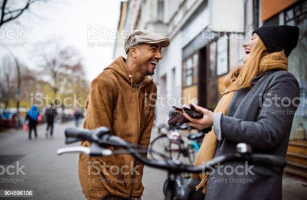 Happy friends with bicycle talking in city picture id904596106?b=1&k=6&m=904596106&s=612x612&h=xzi7p0hkxkyrlpukt8dr qs7wpzvysua3n7tzpvm8b4=