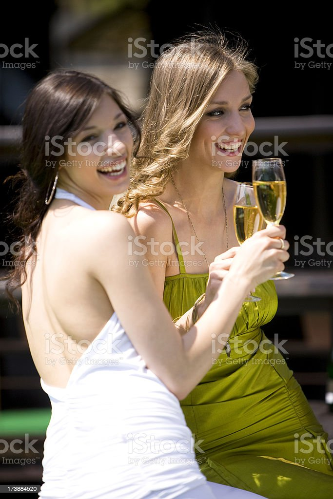 Happy friends with champagne royalty-free stock photo