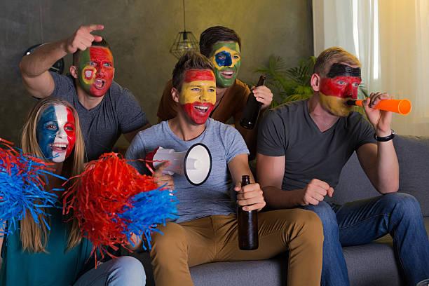 happy friends with colored faces - football portugal flag bildbanksfoton och bilder